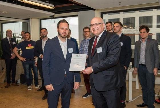 The winning startup: Michal Tresner, ThreatMark with H.E. Roman Buzek.